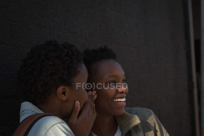 Twins siblings interacting with each other in city street — Stock Photo