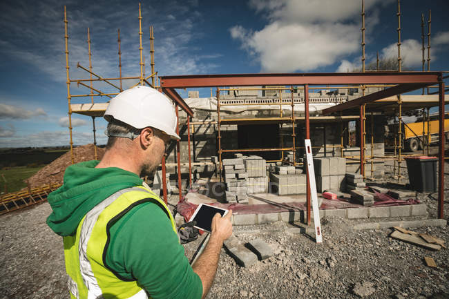 Engineer using digital tablet at the construction site — Stock Photo