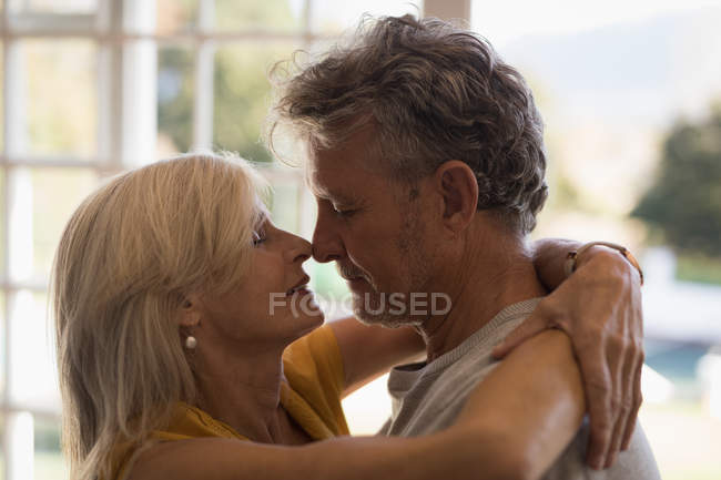 Close-up of romantic senior couple dancing together at home — Stock Photo