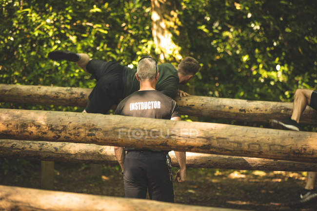 Fit man training on fitness trail at boot camp — Stock Photo