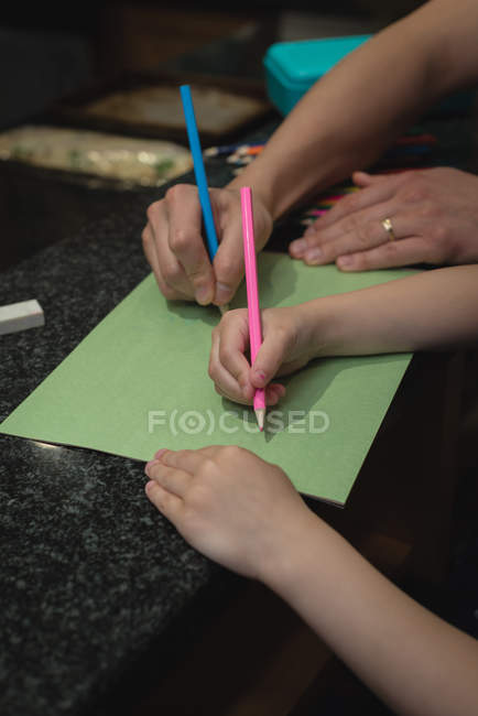 Father and girl drawing a sketch at home — Stock Photo