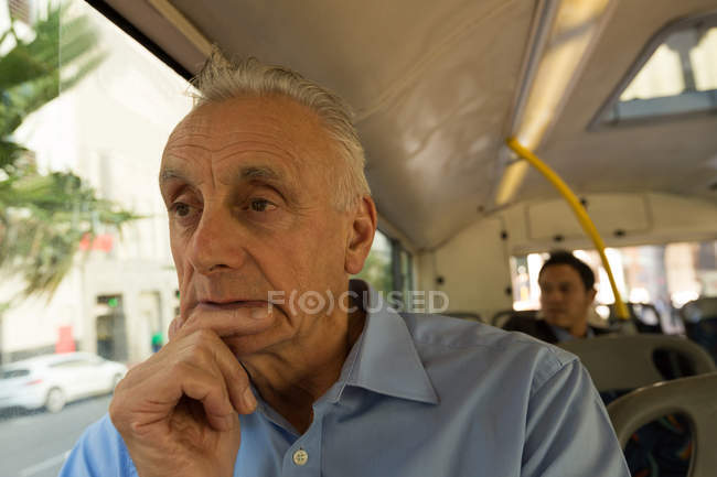 Thoughtful of senior man travelling in the bus — Stock Photo