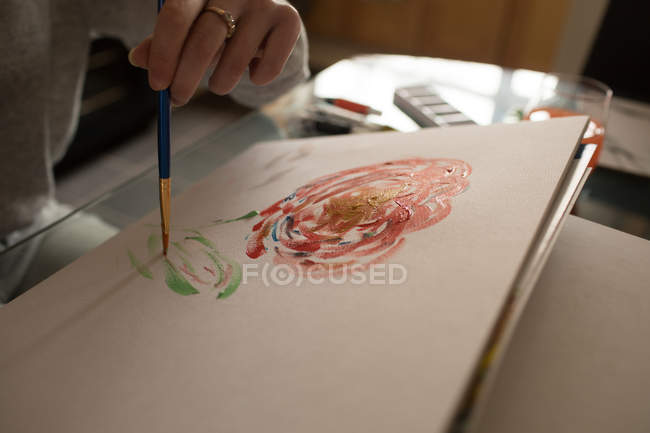 Mid section of woman coloring a sketch at home — Stock Photo