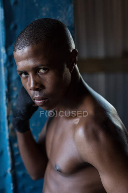 Portrait of male boxer at fitness studio — Stock Photo