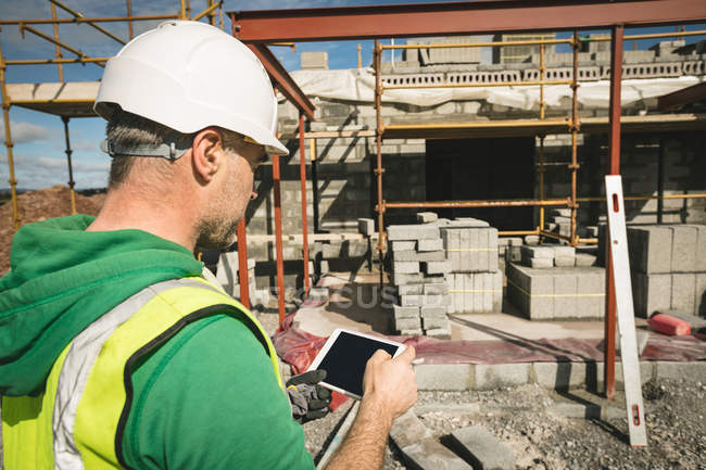 Close-up of engineer using digital tablet at the construction site — Stock Photo