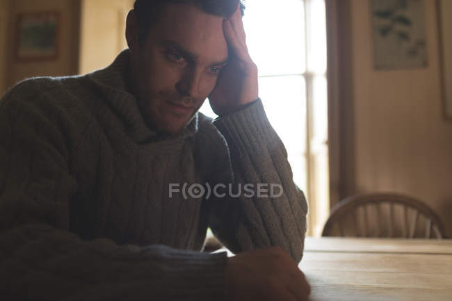 Thoughtful depressed man relaxing at home — Stock Photo
