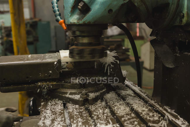 Waste material of plastic being cut into the milling machine at workshop — Stock Photo