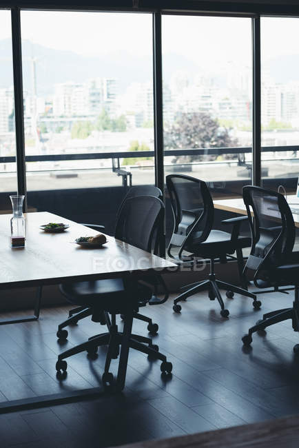 Empty desk with chairs and table in office — Stock Photo