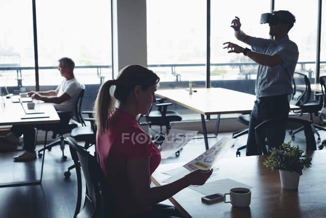 Business people working and using virtual reality headset in office — Stock Photo