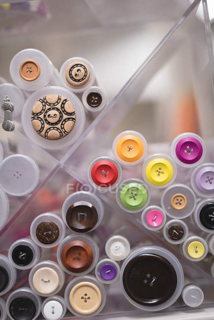 Various size and colour of buttons displayed in tailor shop — Stock Photo