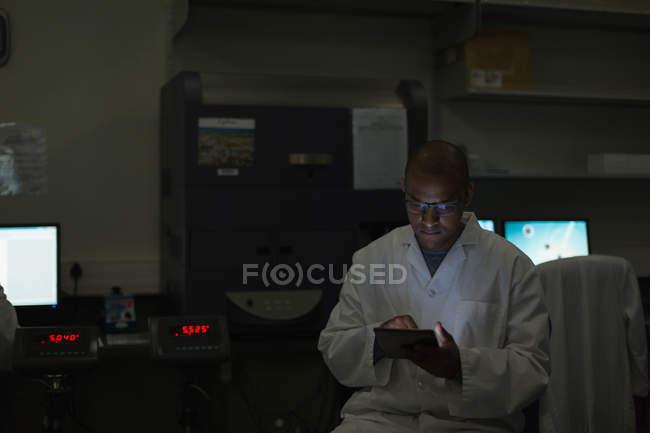 Scientist using digital tablet in science lab — Stock Photo