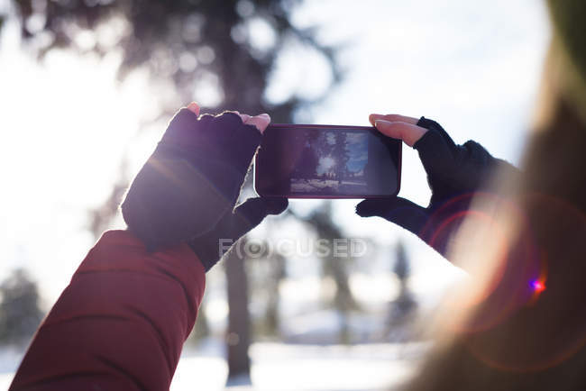 Close-up of woman clicking a picture on smart phone — Stock Photo