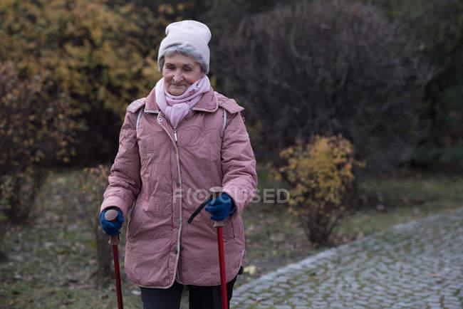 Active senior woman walking outdoors — Stock Photo