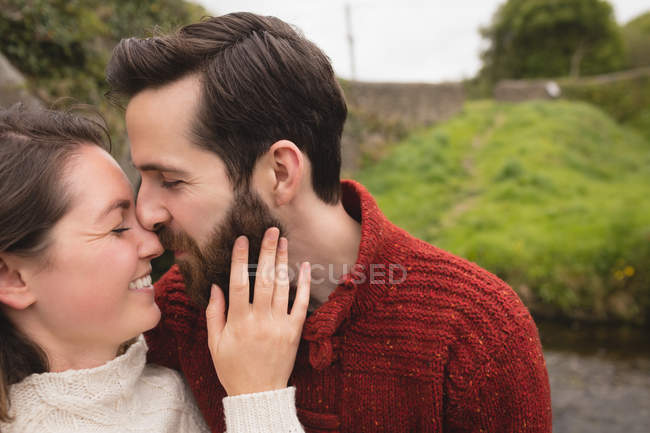 Affectionate couple kissing each other — Stock Photo