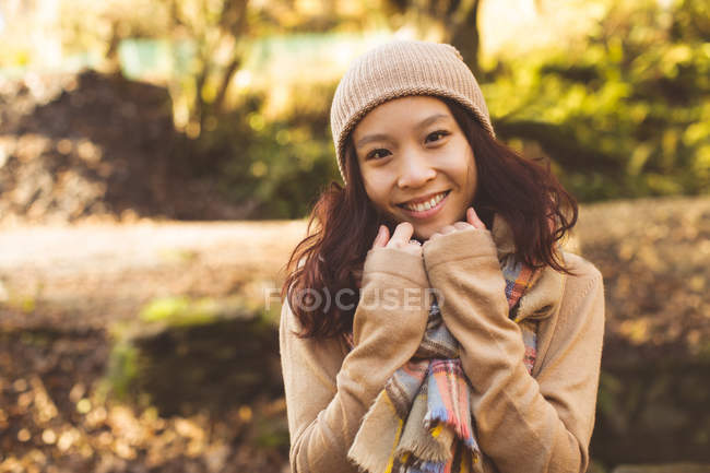 Portrait of woman in warm clothing during autumn — Stock Photo