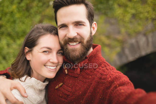 Portrait of happy couple embracing each other — Stock Photo