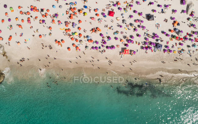 Aerial view of tourists sunbathing at beach in summer. — Stock Photo