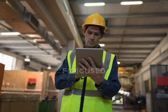 Attentive male worker using digital tablet at solar station — Stock Photo