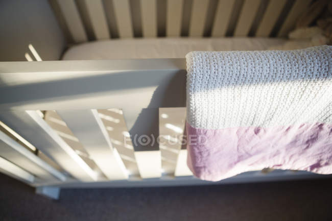 Close-up of wooden cradle at home — Stock Photo