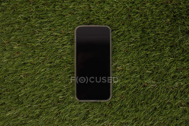 Mobile phone of artificial grass — Stock Photo