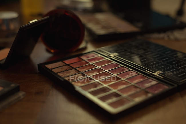 Close-up of eye shadow pallete at table indoors — Stock Photo