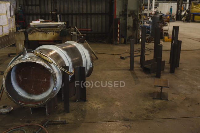 Welding machine on cylindrical vessel part for repair in workshop — Stock Photo