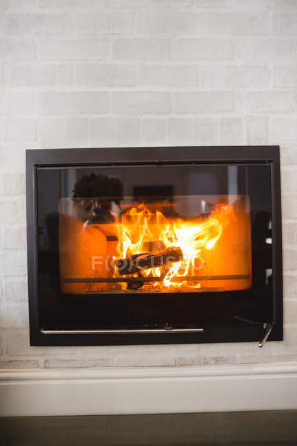 Burning fireplace at home — Stock Photo