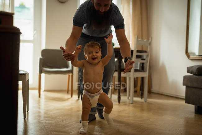 Father playing with son at home — Stock Photo