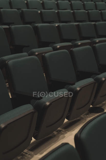 Empty rows of black seats in theater. — Stock Photo