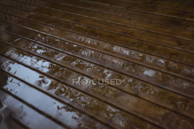 Wet wooden floor after rain with reflection — Stock Photo