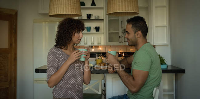 Couple having coffee together at home — Stock Photo
