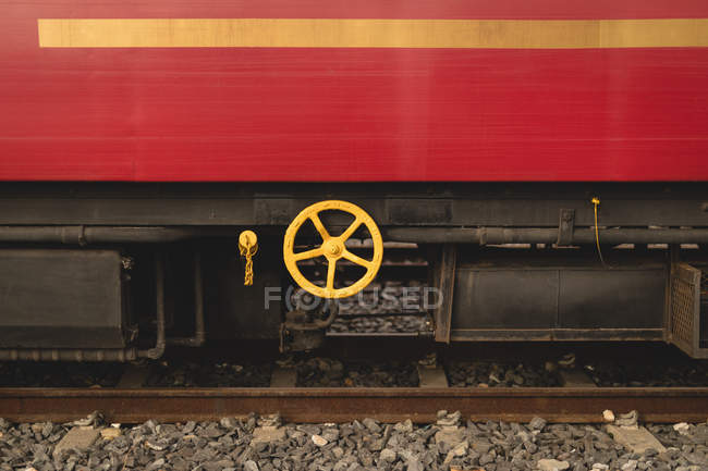 Red train on railway track — Stock Photo