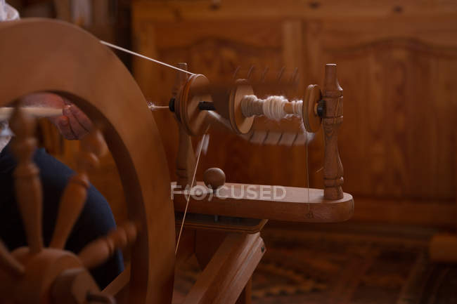 Close-up of weaving loom with silk thread at shop — Stock Photo