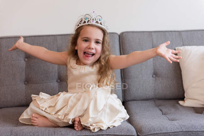 Cute girl wearing crown celebrating her birthday at home — Stock Photo