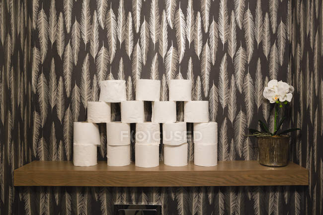 Stack of toilet paper arranged at home — Stock Photo