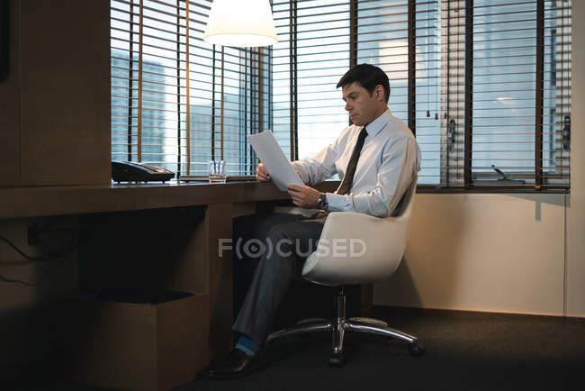 Businessman verifying documents in office bedroom — Stock Photo