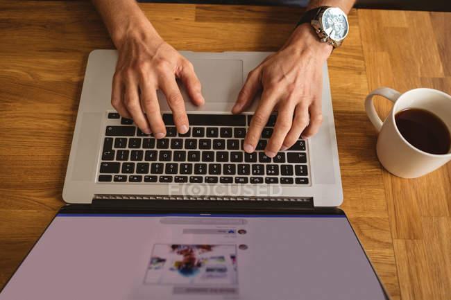 Close-up of man using his laptop — Stock Photo