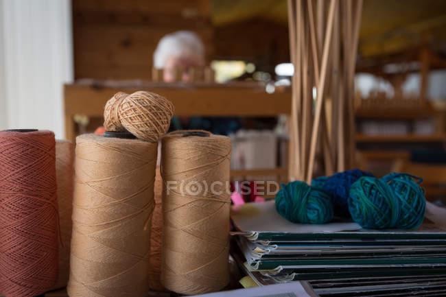 Various silk thread kept in shop — Stock Photo