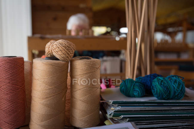 Various silk thread kept in shop — Stock Photo