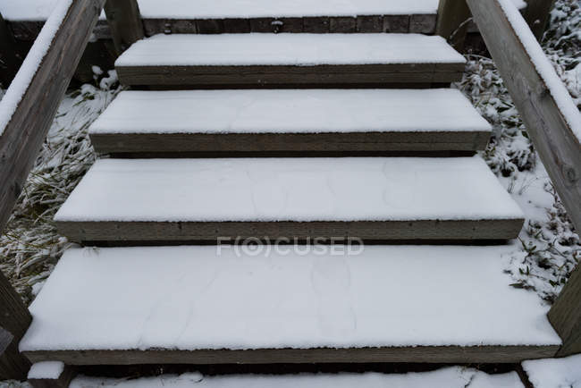 Wooden steps covered with snow during winter — Stock Photo