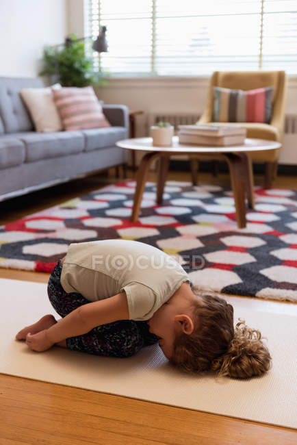 Girl doing meditation in living room at home — Stock Photo