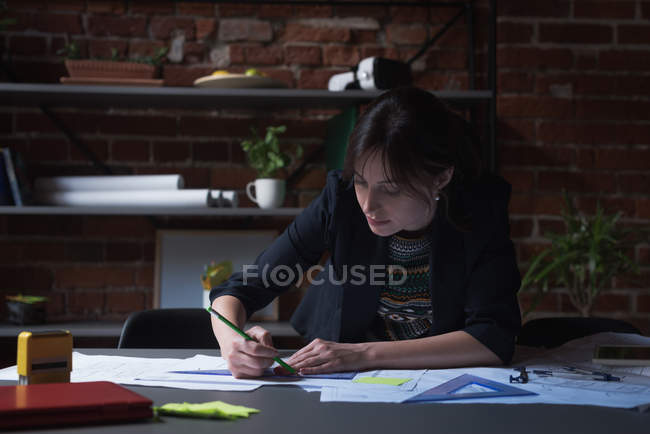 Young female executive working in office — Stock Photo