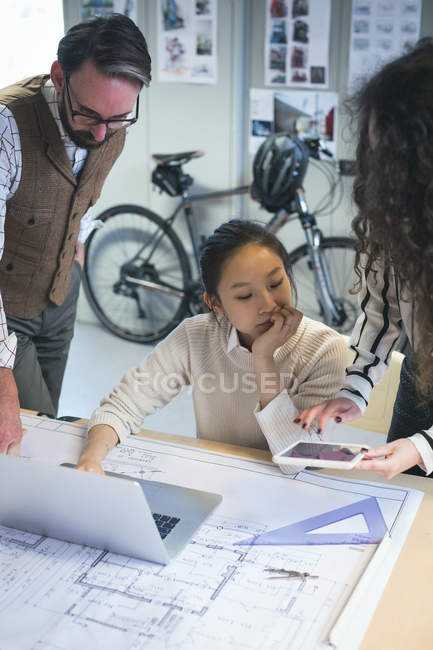 Executives working on laptop in modern office — Stock Photo