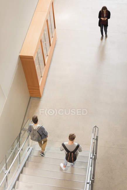 High angle view of college students walking on staircase — Stock Photo