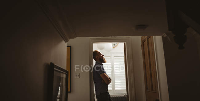 Depressed man lining on wall at home — Stock Photo