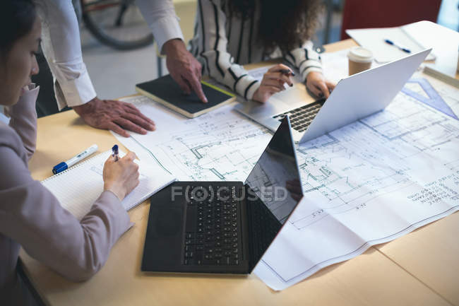 Executives working together in in modern office — Stock Photo