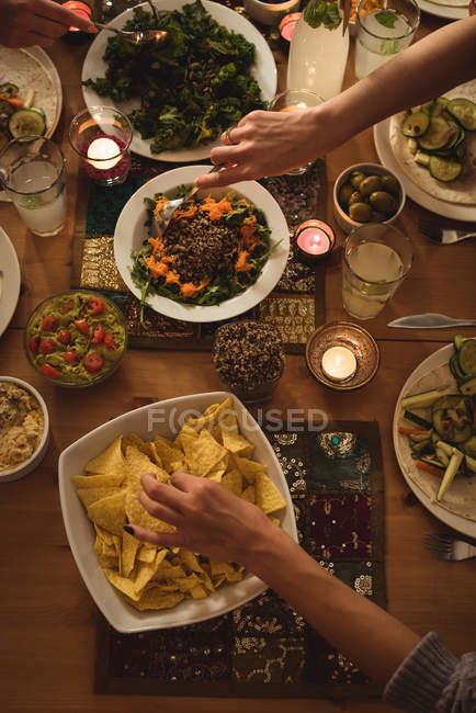 High angle view of friends having meal at table — Stock Photo