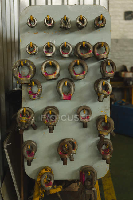 Rustic equipment hanging on hook in workshop — Stock Photo