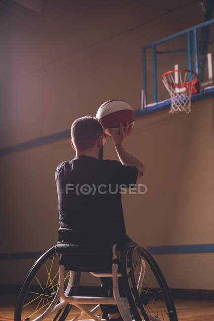 Rear view of disabled man practicing basketball in the court — Stock Photo