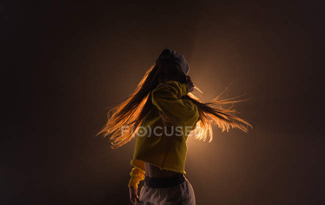 Close-up of young woman dancing in the studio — Stock Photo